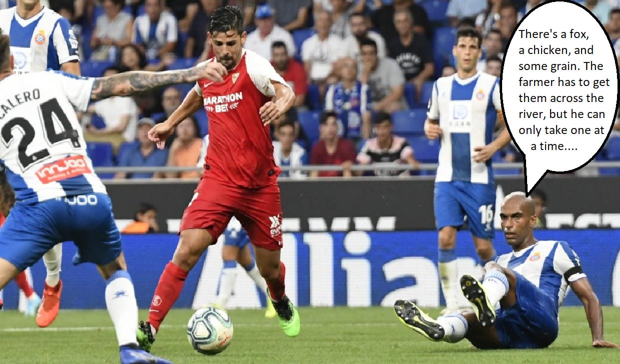 Espanyol defenders look on as Sevilla's Nolito prepares to shoot.
